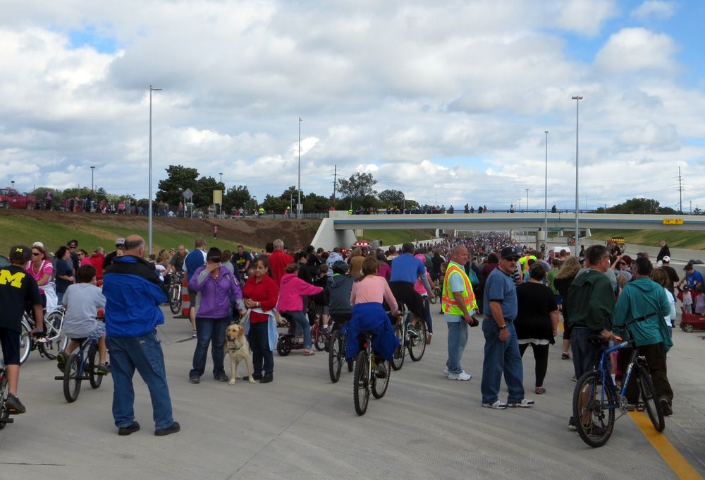 People crowd Interstate 96 expressway as they walk, skate, and bicycle for Family Fun Day